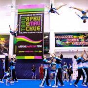"Fly high as cheerleaders in the discipline ""Cheer Coed""!"